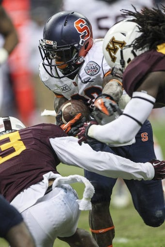Dec 27, 2013; Houston, TX, USA; Syracuse Orange wide receiver Brisly Estime (20) rushes during the fourth quarter of the Texas Bowl against the Minnesota Golden Gophers at Reliant Stadium . Mandatory Credit: Troy Taormina-USA TODAY Sports
