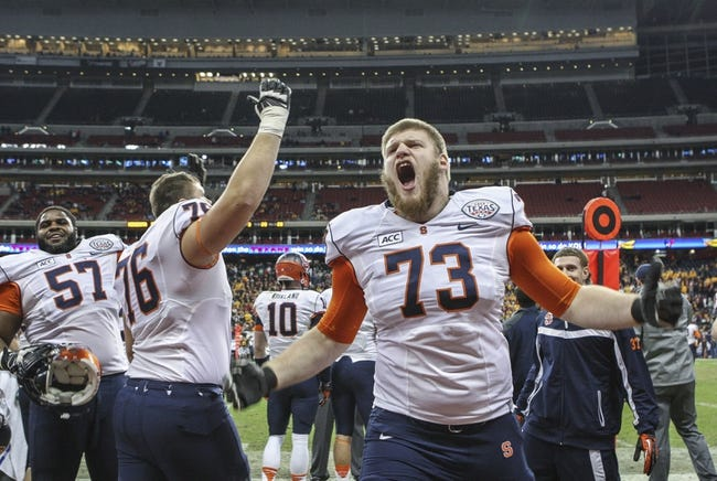 Dec 27, 2013; Houston, TX, USA; Syracuse Orange offensive linesman Jon Burton (73) reacts after a play during the fourth quarter of the Texas Bowl against the Minnesota Golden Gophers at Reliant Stadium . The Orange defeated the Golden Gophers 21-17. Mandatory Credit: Troy Taormina-USA TODAY Sports