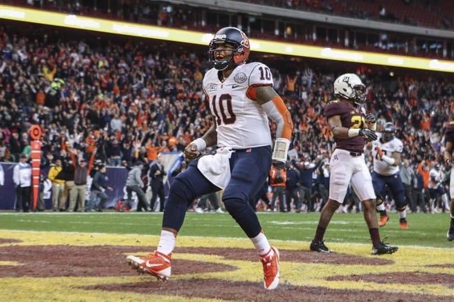Dec 27, 2013; Houston, TX, USA; Syracuse Orange quarterback Terrel Hunt (10) reacts after scoring a touchdown during the fourth quarter of the Texas Bowl against the Minnesota Golden Gophers at Reliant Stadium . The Orange defeated the Golden Gophers 21-17. Mandatory Credit: Troy Taormina-USA TODAY Sports