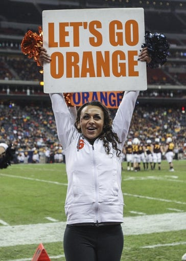 Dec 27, 2013; Houston, TX, USA; A Syracuse Orange cheerleader cheers during the third quarter of the Texas Bowl against the Minnesota Golden Gophers at Reliant Stadium . Mandatory Credit: Troy Taormina-USA TODAY Sports