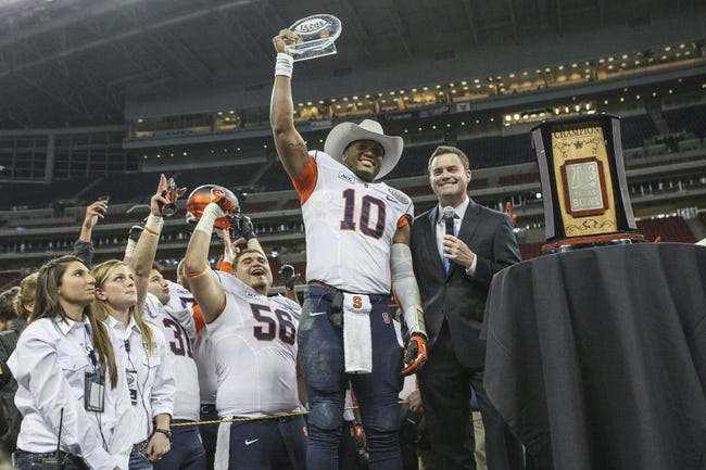 Dec 27, 2013; Houston, TX, USA; Syracuse Orange quarterback Terrel Hunt (10) receives the most valuable player trophy after the Texas Bowl against the Minnesota Golden Gophers at Reliant Stadium . The Orange defeated the Golden Gophers 21-17. Mandatory Credit: Troy Taormina-USA TODAY Sports