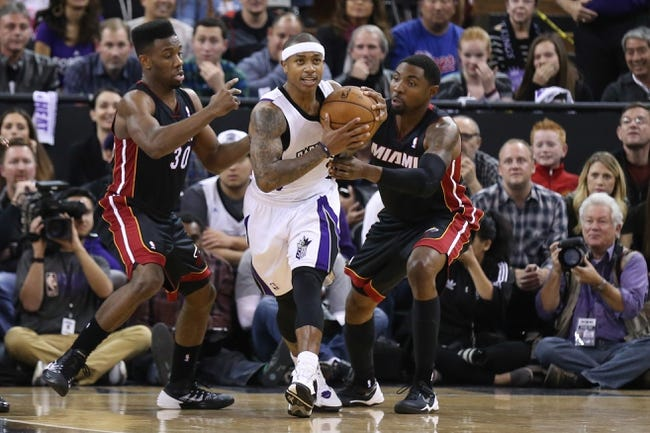Dec 27, 2013; Sacramento, CA, USA; Miami Heat point guard Norris Cole (30) and shooting guard Roger Mason Jr. (21) combine for a foul against Sacramento Kings point guard Isaiah Thomas (22) in the final seconds of overtime at Sleep Train Arena. The Sacramento Kings defeated the Miami Heat 108-103 in overtime. Mandatory Credit: Kelley L Cox-USA TODAY Sports