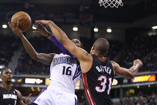 Dec 27, 2013; Sacramento, CA, USA; Sacramento Kings shooting guard Ben McLemore (16) goes up for a basket against Miami Heat small forward Shane Battier (31) during the third quarter at Sleep Train Arena. The Sacramento Kings defeated the Miami Heat 108-103 in overtime. Mandatory Credit: Kelley L Cox-USA TODAY Sports