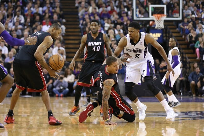 Dec 27, 2013; Sacramento, CA, USA; Miami Heat small forward Michael Beasley (8) passes out the ball to power forward Rashard Lewis (9) from the floor against Sacramento Kings small forward Rudy Gay (8)during the fourth quarter at Sleep Train Arena. The Sacramento Kings defeated the Miami Heat 108-103 in overtime. Mandatory Credit: Kelley L Cox-USA TODAY Sports