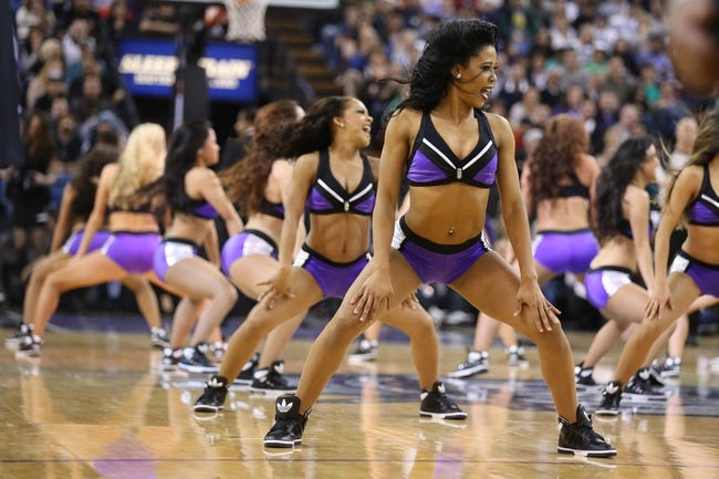 Dec 27, 2013; Sacramento, CA, USA; Sacramento Kings dancer performs during a timeout against the Miami Heat during the fourth quarter at Sleep Train Arena. The Sacramento Kings defeated the Miami Heat 108-103 in overtime. Mandatory Credit: Kelley L Cox-USA TODAY Sports
