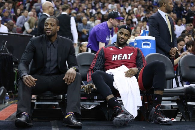 Dec 27, 2013; Sacramento, CA, USA; Miami Heat shooting guard Dwyane Wade (3) and small forward LeBron James (6) on the bench during the fourth quarter against the Sacramento Kings at Sleep Train Arena. The Sacramento Kings defeated the Miami Heat 108-103 in overtime. Mandatory Credit: Kelley L Cox-USA TODAY Sports