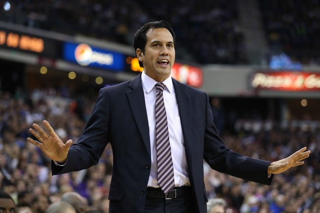 Dec 27, 2013; Sacramento, CA, USA; Miami Heat head coach Erik Spoelstra speaks to the referee after a traveling call during the fourth quarter against the Sacramento Kings at Sleep Train Arena. The Sacramento Kings defeated the Miami Heat 108-103 in overtime. Mandatory Credit: Kelley L Cox-USA TODAY Sports