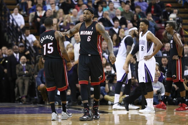 Dec 27, 2013; Sacramento, CA, USA; Miami Heat small forward LeBron James (6) pats point guard Mario Chalmers (15) after a play against the Sacramento Kings during the fourth quarter at Sleep Train Arena. The Sacramento Kings defeated the Miami Heat 108-103 in overtime. Mandatory Credit: Kelley L Cox-USA TODAY Sports