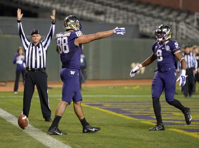 Dec 27, 2013; San Francisco, CA, USA; Washington Huskies tight end Austin Seferian-Jenkins (88) celebrates with receiver Da'More'ea Stringfellow (9) after scoring on a 16-yard touchdown reception in the third quarter against the BYU Cougars in the 2013 Fight Hunger Bowl at AT&T Park. Mandatory Credit: Kirby Lee-USA TODAY Sports