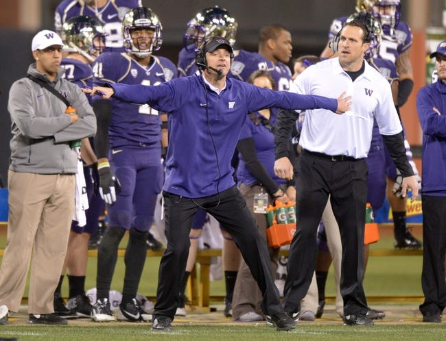 Dec 27, 2013; San Francisco, CA, USA; Washington Huskies defensive coordinator Justin Wilcox reacts during the 2013 Fight Hunger Bowl against the BYU Cougars at AT&T Park. Washington defeated BYU 31-16. Mandatory Credit: Kirby Lee-USA TODAY Sports