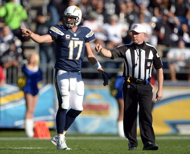 Dec 22, 2013; San Diego, CA, USA; San Diego Chargers quarterback Philip Rivers (17) talks with referee Walt Anderson (66) during the first half against the Oakland Raiders at Qualcomm Stadium. Mandatory Credit: Kirby Lee-USA TODAY Sports