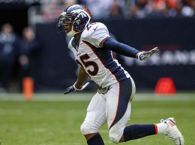 Dec 22, 2013; Houston, TX, USA; Denver Broncos cornerback Chris Harris (25) reacts after a defensive play during the third quarter against the Houston Texans at Reliant Stadium. Mandatory Credit: Troy Taormina-USA TODAY Sports