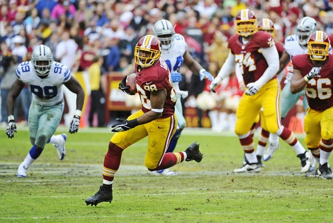 Dec 22, 2013; Landover, MD, USA; Washington Redskins wide receiver Pierre Garcon (88) runs after a reception against the Dallas Cowboys during the first half at FedEx Field. Mandatory Credit: Brad Mills-USA TODAY Sports