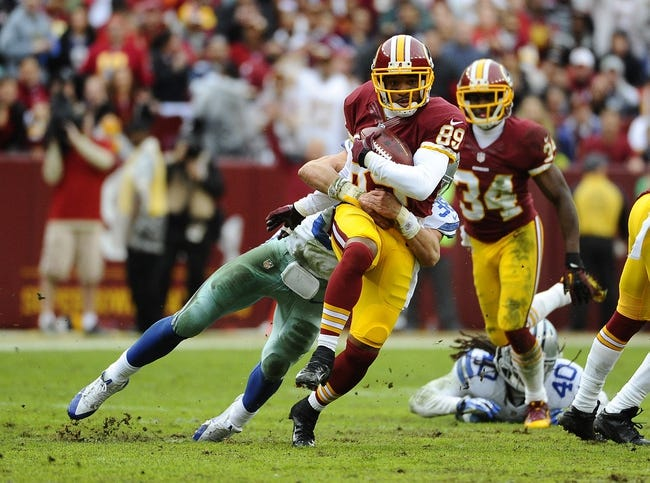 Dec 22, 2013; Landover, MD, USA; Washington Redskins wide receiver Santana Moss (89) returns a punt against the Dallas Cowboys during the first half at FedEx Field. Mandatory Credit: Brad Mills-USA TODAY Sports