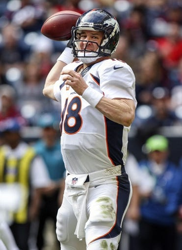 Dec 22, 2013; Houston, TX, USA; Denver Broncos quarterback Peyton Manning (18) attempts a pass during the third quarter against the Houston Texans at Reliant Stadium. Mandatory Credit: Troy Taormina-USA TODAY Sports