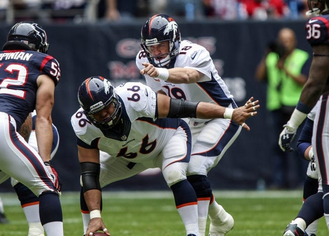 Dec 22, 2013; Houston, TX, USA; Denver Broncos quarterback Peyton Manning (18) calls a play during the first quarter against the Houston Texans at Reliant Stadium. Mandatory Credit: Troy Taormina-USA TODAY Sports