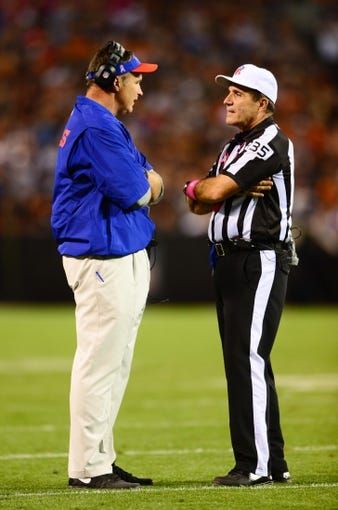 Oct 3, 2013; Cleveland, OH, USA; Buffalo Bills head coach Doug Marrone talks with referee John Hussey (35) during the game against the Cleveland Browns at FirstEnergy Stadium. Mandatory Credit: Andrew Weber-USA TODAY Sports