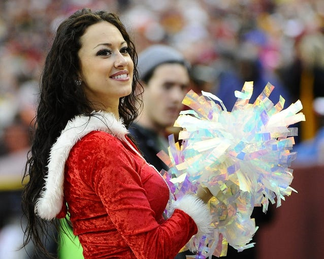 Dec 22, 2013; Landover, MD, USA; Washington Redskins cheerleaders on the field against the Dallas Cowboys during the second half at FedEx Field. Mandatory Credit: Brad Mills-USA TODAY Sports