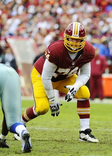 Dec 22, 2013; Landover, MD, USA; Washington Redskins offensive tackle Tyler Polumbus (74) prepares to block against the Dallas Cowboys during the first half at FedEx Field. Mandatory Credit: Brad Mills-USA TODAY Sports