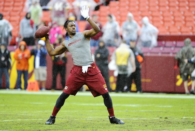 Dec 22, 2013; Landover, MD, USA; Washington Redskins quarterback Robert Griffin III (10) warms up before the game against the Dallas Cowboys at FedEx Field. Mandatory Credit: Brad Mills-USA TODAY Sports