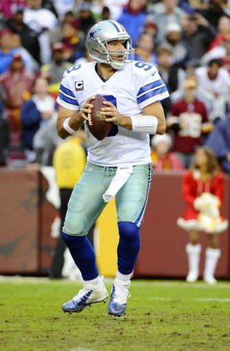 Dec 8, 2013; Landover, MD, USA; Dallas Cowboys quarterback Tony Romo (9) drops back to pass against the Washington Redskins during the second half at FedEx Field. Mandatory Credit: Brad Mills-USA TODAY Sports
