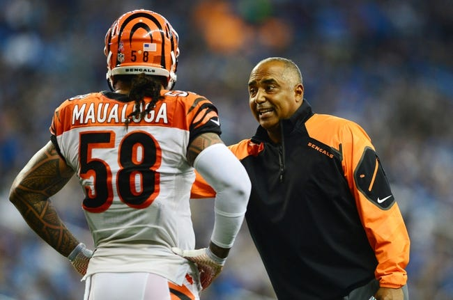Oct 20, 2013; Detroit, MI, USA; Cincinnati Bengals middle linebacker Rey Maualuga (58) talks with head coach Marvin Lewis during the game against the Detroit Lions at Ford Field. Mandatory Credit: Andrew Weber-USA TODAY Sports