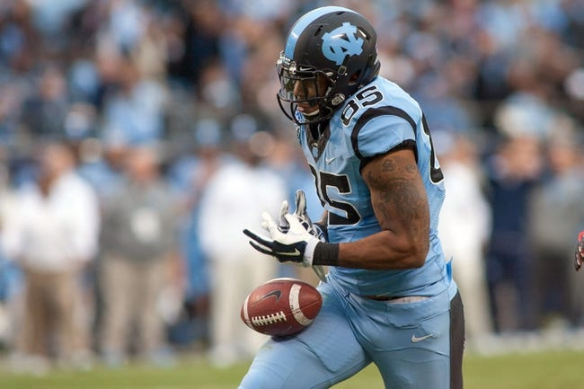 Dec 28, 2013; Charlotte, NC, USA; North Carolina Tar Heels tight end Eric Ebron (85) tries to catch a pass during the second quarter against the Cincinnati Bearcats at Bank of America Stadium. Mandatory Credit: Jeremy Brevard-USA TODAY Sports