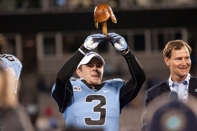 Dec 28, 2013; Charlotte, NC, USA; North Carolina Tar Heels wide receiver Ryan Switzer (3) holds up the MVP trophy after defeating the Cincinnati Bearcats in the Belk Bowl at Bank of America Stadium. Carolina defeated Cincinnati 39-17. Mandatory Credit: Jeremy Brevard-USA TODAY Sports