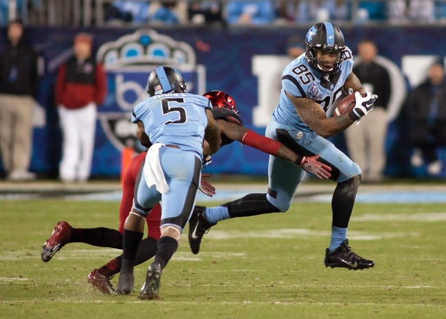 Dec 28, 2013; Charlotte, NC, USA; North Carolina Tar Heels tight end Eric Ebron (85) runs after a catch during the third quarter against the Cincinnati Bearcats in the Belk Bowl at Bank of America Stadium. Carolina defeated Cincinnati 39-17. Mandatory Credit: Jeremy Brevard-USA TODAY Sports