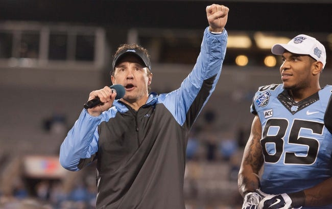 Dec 28, 2013; Charlotte, NC, USA; North Carolina Tar Heels head coach Larry Fedora speaks after defeating the Cincinnati Bearcats in the Belk Bowl at Bank of America Stadium. Carolina defeated Cincinnati 39-17. Mandatory Credit: Jeremy Brevard-USA TODAY Sports