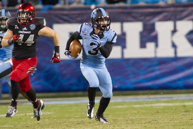 Dec 28, 2013; Charlotte, NC, USA; North Carolina Tar Heels wide receiver Ryan Switzer (3) returns a punt for a touchdown during the third quarter against the Cincinnati Bearcats in the Belk Bowl at Bank of America Stadium. Carolina defeated Cincinnati 39-17. Mandatory Credit: Jeremy Brevard-USA TODAY Sports