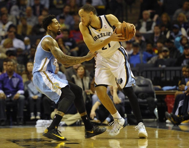 Dec 28, 2013; Memphis, TN, USA; Denver Nuggets small forward Wilson Chandler (21) guards Memphis Grizzlies small forward Tayshaun Prince (21) at FedExForum. Mandatory Credit: Justin Ford-USA TODAY Sports
