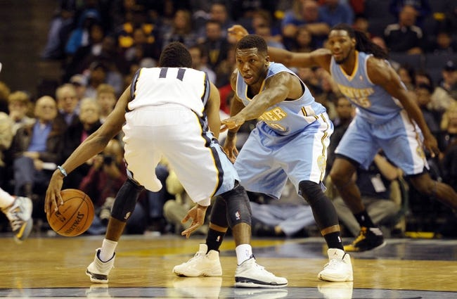 Dec 28, 2013; Memphis, TN, USA; Denver Nuggets point guard Nate Robinson (10) guards Memphis Grizzlies point guard Mike Conley (11) during the fourth quarter at FedExForum. Memphis Grizzlies beat Denver Nuggets 120 -99. Mandatory Credit: Justin Ford-USA TODAY Sports