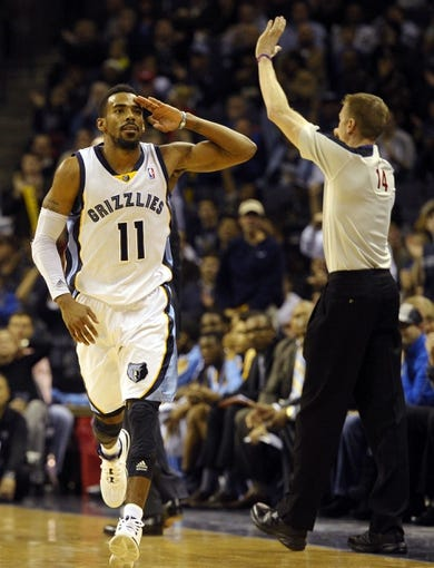Dec 28, 2013; Memphis, TN, USA; Memphis Grizzlies point guard Mike Conley (11) celebrates against the Denver Nuggets during the fourth quarter at FedExForum. Memphis Grizzlies beat the Denver Nuggets 120-99. Mandatory Credit: Justin Ford-USA TODAY Sports
