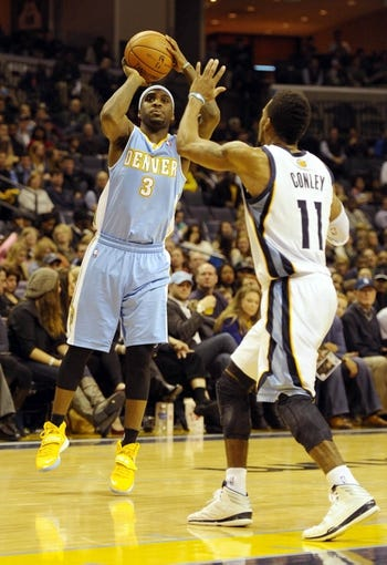 Dec 28, 2013; Memphis, TN, USA; Denver Nuggets point guard Ty Lawson (3) shoots over Memphis Grizzlies point guard Mike Conley (11) during the fourth quarter at FedExForum. Memphis Grizzlies beat the Denver Nuggets 120-99. Mandatory Credit: Justin Ford-USA TODAY Sports