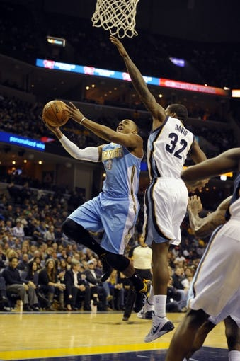 Dec 28, 2013; Memphis, TN, USA; Denver Nuggets shooting guard Randy Foye (4) lays the ball up against Memphis Grizzlies power forward Ed Davis (32) during the fourth quarter at FedExForum. Memphis Grizzlies beat the Denver Nuggets 120-99. Mandatory Credit: Justin Ford-USA TODAY Sports