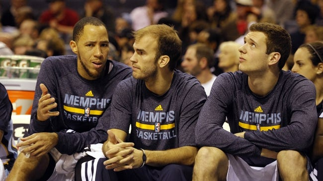 Dec 28, 2013; Memphis, TN, USA; Memphis Grizzlies small forward Tayshaun Prince (21) , shooting guard Nick Calathes (12) and power forward Jon Leuer (30) on the bench against the Denver Nuggets during the fourth quarter at FedExForum. Memphis Grizzlies beat the Denver Nuggets 120-99. Mandatory Credit: Justin Ford-USA TODAY Sports