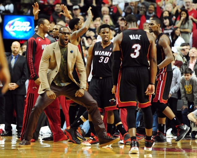 Dec 28, 2013; Portland, OR, USA; Miami Heat small forward LeBron James (left) and teammate Dwyane Wade (3) react after center Chris Bosh (right) hit the game winning shot during the fourth quarter of the game against the Portland Trail Blazers at the Moda Center. The Heat won the game 108-107. Mandatory Credit: Steve Dykes-USA TODAY Sports