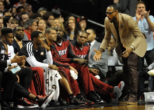 Dec 28, 2013; Portland, OR, USA; Miami Heat small forward LeBron James (right) calls out from the bench during the fourth quarter of the game against the Portland Trail Blazers at the Moda Center. The Heat won the game 108-107. Mandatory Credit: Steve Dykes-USA TODAY Sports