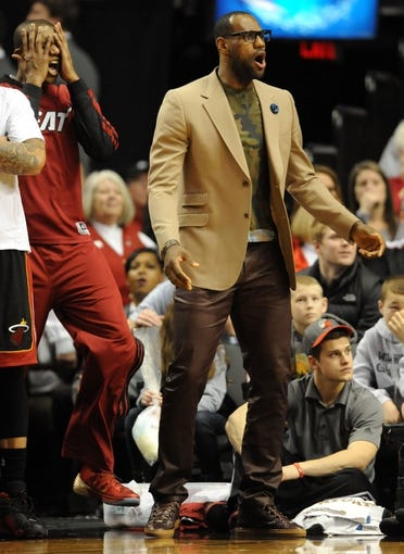 Dec 28, 2013; Portland, OR, USA; Miami Heat small forward LeBron James (6) reacts to an officials call during the fourth quarter of the game against the Portland Trail Blazersat the Moda Center. The Heat won the game 108-107. Mandatory Credit: Steve Dykes-USA TODAY Sports