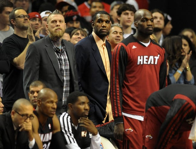 Dec 28, 2013; Portland, OR, USA; Miami Heat power forward Chris Andersen and center Greg Oden look on from the benchduring the fourth quarter of the game against the Portland Trail Blazers at the Moda Center. The Heat won the game 108-107. Mandatory Credit: Steve Dykes-USA TODAY Sports