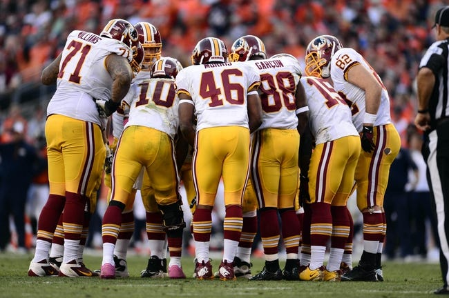 Oct 27, 2013; Denver, CO, USA; Washington Redskins quarterback Robert Griffin III (10) huddles with tackle Trent Williams (71) and running back Alfred Morris (46) and wide receiver Pierre Garcon (88) and  wide receiver Josh Morgan (15) and tight end Logan Paulsen (82) in the third quarter against the Denver Broncos at Sports Authority Field at Mile High. Mandatory Credit: Ron Chenoy-USA TODAY Sports