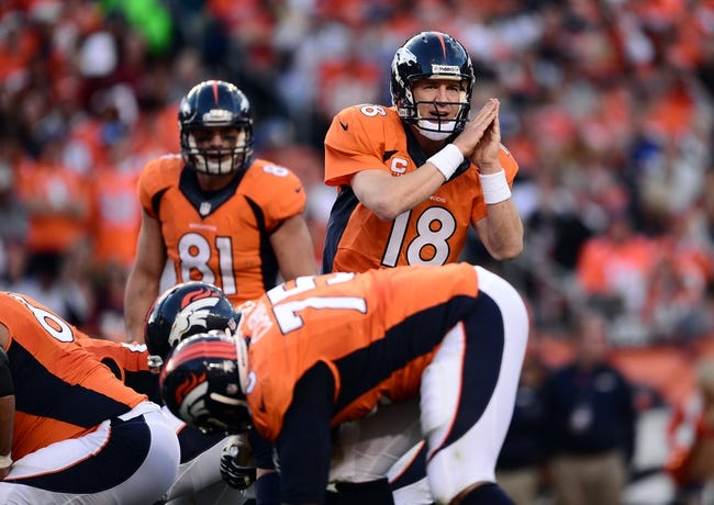 Oct 27, 2013; Denver, CO, USA; Denver Broncos quarterback Peyton Manning (18) calls an audible in the third quarter against the Washington Redskins at Sports Authority Field at Mile High. Mandatory Credit: Ron Chenoy-USA TODAY Sports