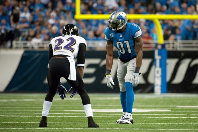 Dec 16, 2013; Detroit, MI, USA; Detroit Lions wide receiver Calvin Johnson (81) and Baltimore Ravens cornerback Jimmy Smith (22) during the game at Ford Field. Mandatory Credit: Tim Fuller-USA TODAY Sports