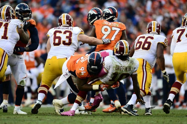 Oct 27, 2013; Denver, CO, USA; Denver Broncos defensive tackle Terrance Knighton (94) tackles Washington Redskins quarterback Robert Griffin III (10) in the fourth quarter at Sports Authority Field at Mile High. Mandatory Credit: Ron Chenoy-USA TODAY Sports