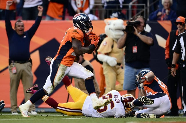Oct 27, 2013; Denver, CO, USA; Denver Broncos running back Knowshon Moreno (27) scores on thirty five yard touchdown pass in the fourth quarter against the Washington Redskins at Sports Authority Field at Mile High. Mandatory Credit: Ron Chenoy-USA TODAY Sports