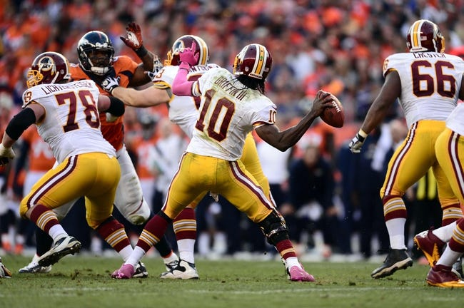 Oct 27, 2013; Denver, CO, USA; Washington Redskins quarterback Robert Griffin III (10) passes the ball in the fourth quarter against the Denver Broncos at Sports Authority Field at Mile High. Mandatory Credit: Ron Chenoy-USA TODAY Sports