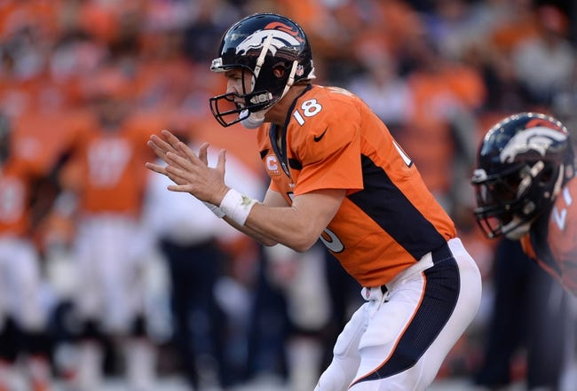 Oct 27, 2013; Denver, CO, USA; Denver Broncos quarterback Peyton Manning (18) calls for a hike the third quarter against the Washington Redskins at Sports Authority Field at Mile High. Mandatory Credit: Ron Chenoy-USA TODAY Sports