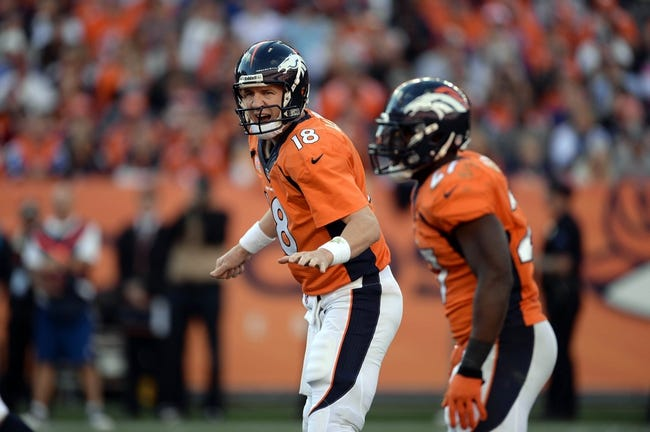 Oct 27, 2013; Denver, CO, USA; Denver Broncos quarterback Peyton Manning (18) calls out in the fourth quarter against the Washington Redskins at Sports Authority Field at Mile High. Mandatory Credit: Ron Chenoy-USA TODAY Sports