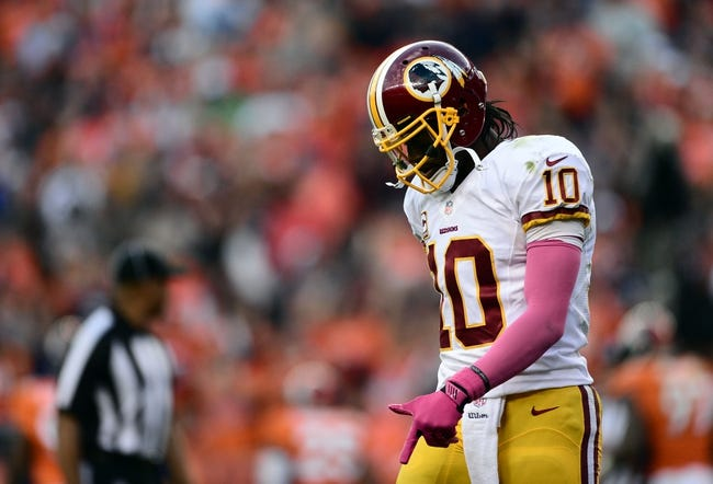 Oct 27, 2013; Denver, CO, USA; Washington Redskins quarterback Robert Griffin III (10) walks of the field following a third down attempt in the fourth quarter against the Denver Broncos at Sports Authority Field at Mile High. Mandatory Credit: Ron Chenoy-USA TODAY Sports
